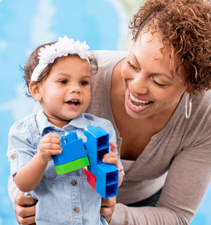 Mother Holding Child With Toy