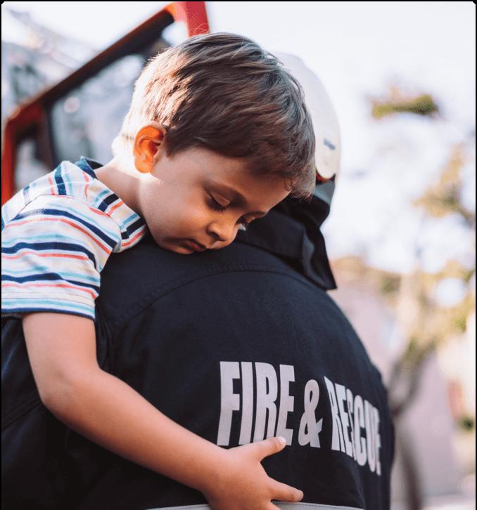 Firefighter Holding Child