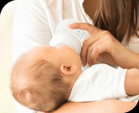 Mom Bottle Feeding Baby