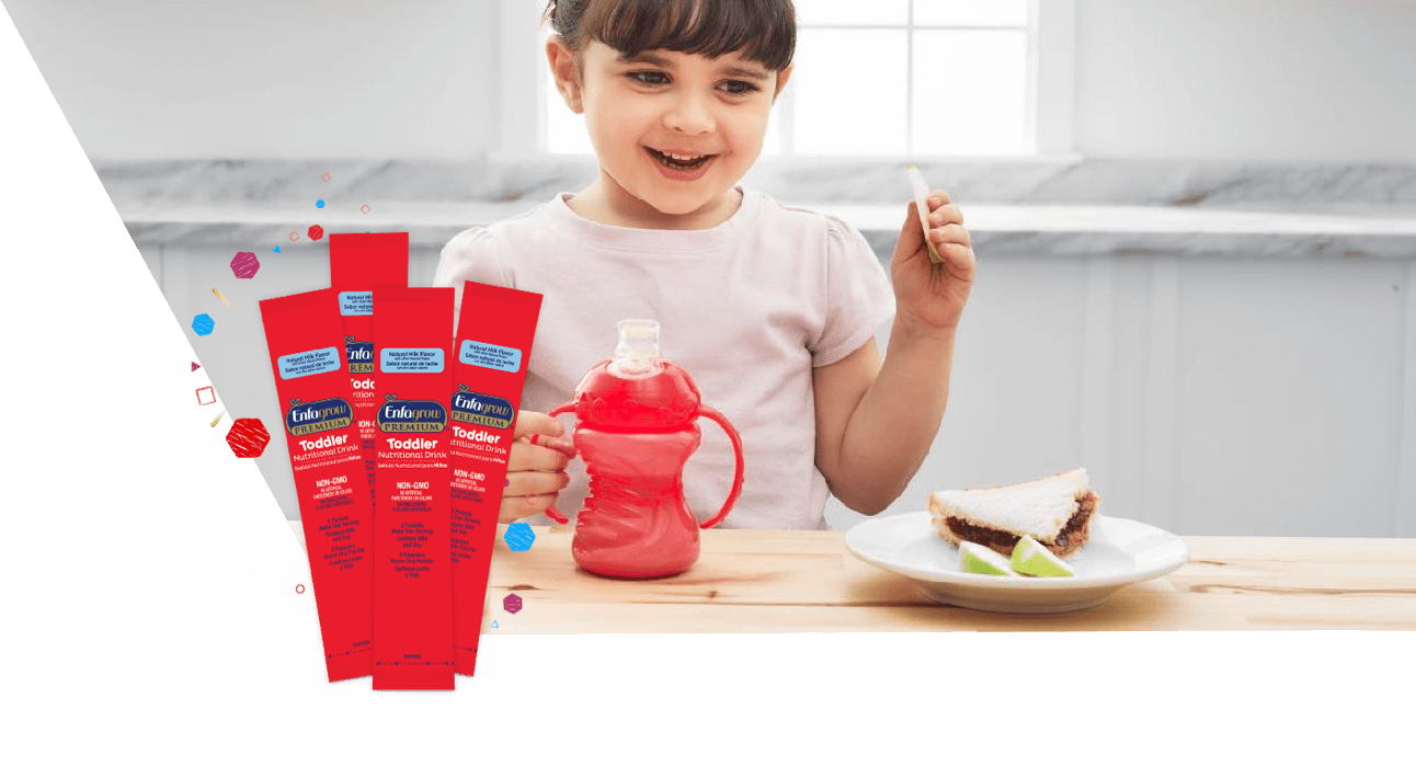 Toddler Holding Cup Excited With Enfagrow