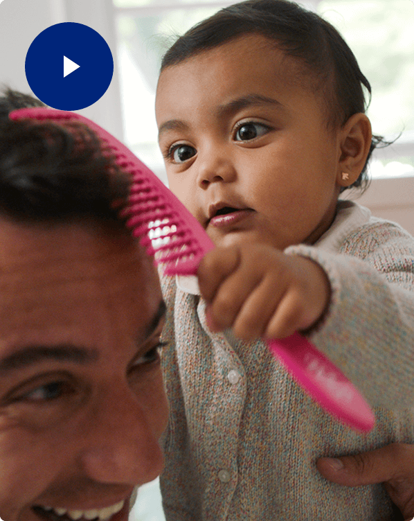 Babying Combing Father's Hair