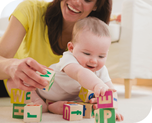 Mom and Baby Playing With Blocks