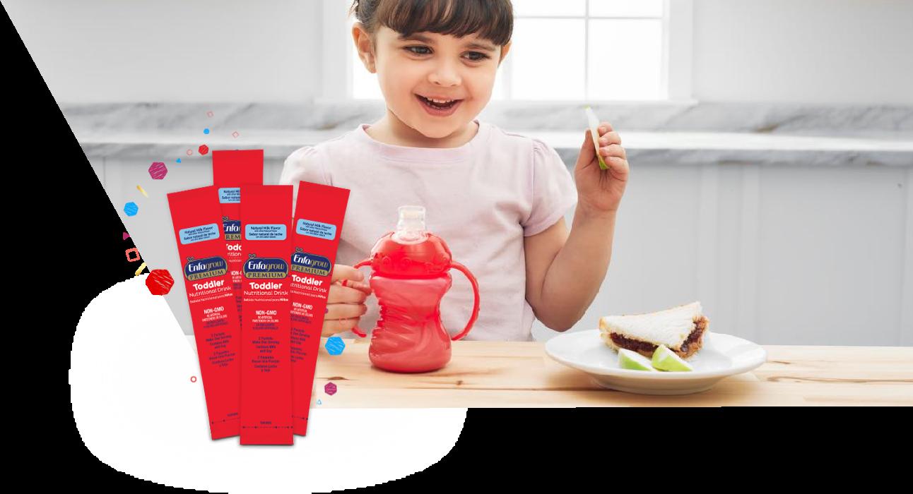 Toddler Drinking Enfamil Nutritional Drink